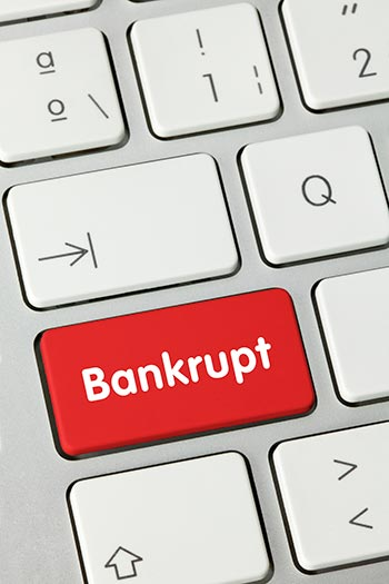 red bankruptcy computer keyboard key